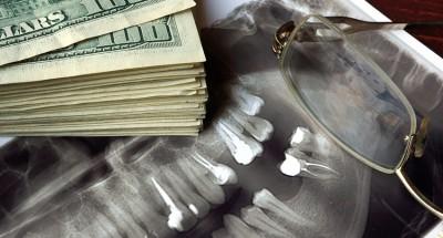 Cost of dental treatment. Dentures concept.