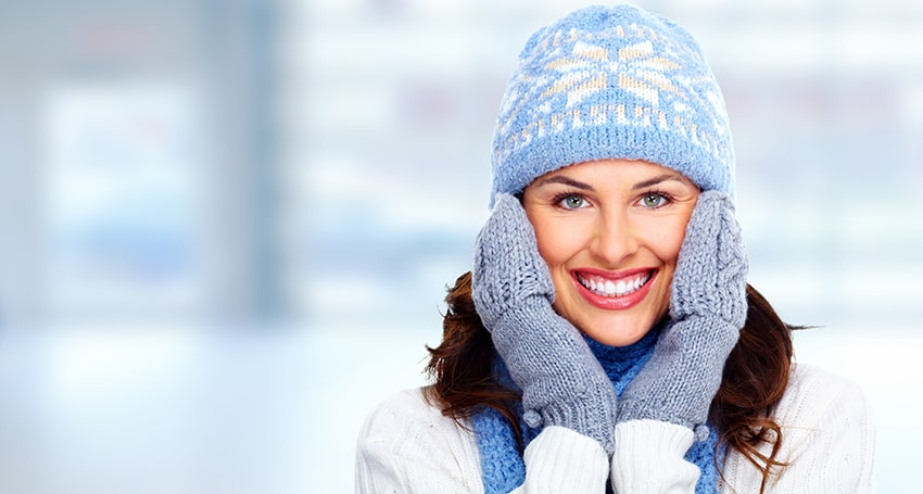 Attractive woman shows off her Anchorage smile makeover during winter time