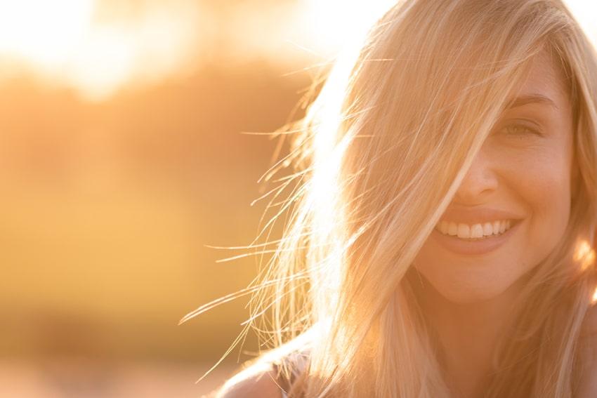 beautiful woman enjoying the sunshine, vitamin D