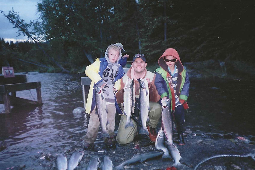 Dr. Kendall Skinner with his family, catching fish in Anchorage