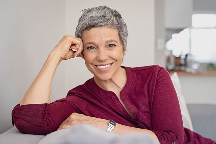 mature woman relaxing on her couch at home