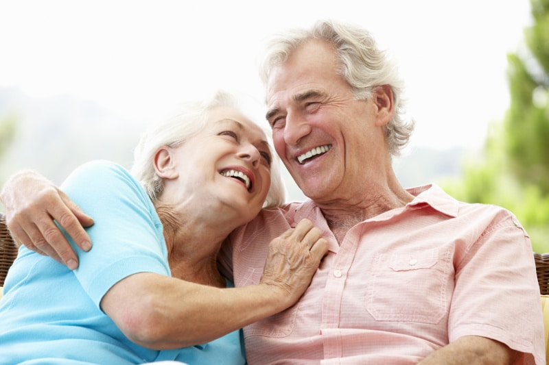A happy older couple because of their dentures