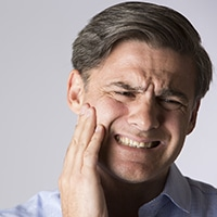 A man suffering from jaw pain